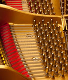 Inside grand piano. Detail inside the body of a black lacquered grand piano royalty free stock photos