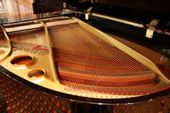 Inside of Grand Piano. With Strings and Gold Trim royalty free stock images
