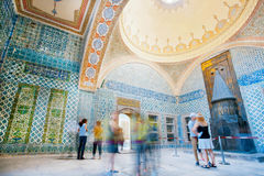 Inside of great Topkapi palace with colorful tiles and walking tourists, Turkey Royalty Free Stock Photo