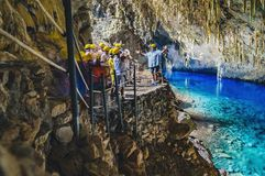 Inside the grotto of Lagoa Azul, a group of tourists. Bonito, Brazil - November 19, 2017: Inside the grotto of Lagoa Azul, a group of tourists visiting the Stock Photography