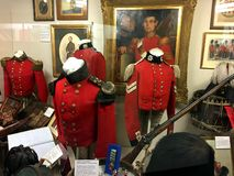 Inside the Guards Museum of London, exhibits of uniforms and weapons