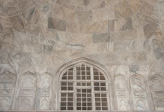 Inside half dome with screened window at Taj Mahal Stock Photo