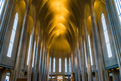 Inside of the Hallgrimskirkja church in Reykjavik. The inside of the Hallgrimskirkja cathedral in Reykjavik, Iceland. Raw, unornamented walls with pointy arches stock photos