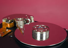 Inside of hard disc  on red background Stock Photography