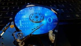 Inside hard disk on keyboard of computer notebook. Stock Images