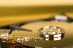 Inside of Hard Drive. A close-up of a computer hard drive with top removed showing silver platter and drive arm Royalty Free Stock Image