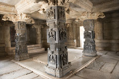 Inside Hindu Temple, Hampi, India. Inside Hindu Temple in the archaeological complex of the ruins of Hampi, India. Hall with black columns with bas-reliefs royalty free stock photos