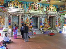 Inside Hindu Temple, Little India, Singapore. Worshippers pray inside the colorful Sri Veeramakaliamman, a Hindu Temple in Little India, Singapore Stock Images