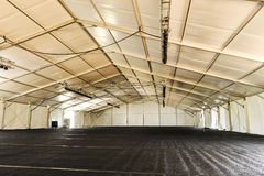 Inside of a huge white tent with rafters Royalty Free Stock Image
