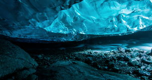 Inside ice cave with flowing river stock video