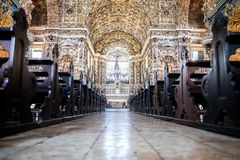 Inside Igreja e Convento de São Francisco in Bahia, Salvador - Brazil. And where people pray and give devotions stock image