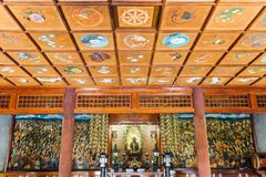 Inside Indosan Nippon Japanese Temple, Lord Buddha statue in the center with wall painted and wooden ceiling at Bodh Gaya. Inside Indosan Nippon Japanese Temple royalty free stock images