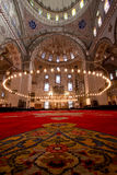 Inside Istanbul Mosque with red carpet. In foreground . Picture with a lot of mosque details and big columns Stock Images