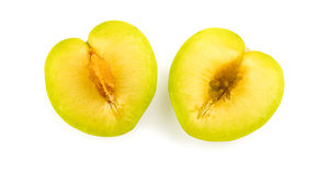 Inside of juicy green plum with seed and core Royalty Free Stock Photography