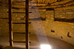 Inside a kiva. Sun-lit inside of the Anasazi Indian kiva in Mesa Verde royalty free stock image