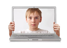 Inside laptop. Young boy inside laptop, hands holding screen, clipping path Stock Photography