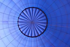The inside of a large blue hot air balloon Royalty Free Stock Images