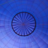 The inside of a large blue hot air balloon round pattern Stock Image