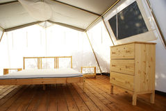 Inside a large luxurious tent. Inside a large tent with luxurious furnishings royalty free stock photography