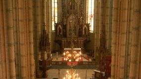 Inside large old Gothic Catholic Church. Zoom out from altar to wide shot ,view from the gallery stock video footage