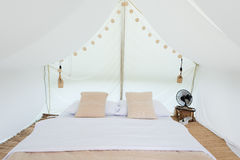 Inside a large white tent camp Stock Photos