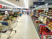 Inside a Lidl supermarket. Shopping cart on the corridor Stock Photography
