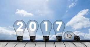 2017 inside light bulbs against a composite image 3D of sky Stock Photos