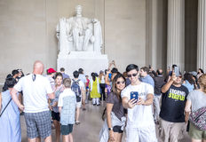 Inside the Lincoln Memorial Monument, Crowds of People making photographs and selfies in front of the Statue. Washington DC, United States of America - August 5 Stock Photography