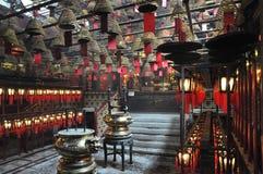 Inside the little Hong Kong Tin Hau temple with lots of wishes. Inside the little Hong Kong Tin Hau temple with lots of red wishes lanterns and incense Stock Photo