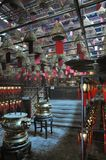 Inside the little Tin Hau temple in Hong Kong with lots of wishes lanterns. Ine the little Tin Hau temple in Hong Kong with lots of wishes lights and incense Royalty Free Stock Photo