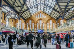 Inside Liverpool Street Station. Liverpool Street, London, UK - April 6, 2018: wide angle shot of a busy mainline station with lots of passengers. Well lit view Royalty Free Stock Photography
