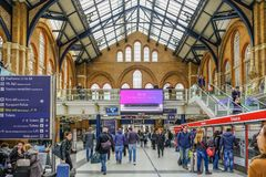 Inside Liverpool Street Station. Liverpool Street, London, UK - April 6, 2018: Wide angle shot of mainline station with lots of passengers Stock Image