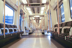 Inside of London tube coach with empty seats Stock Image