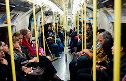 Inside the London tube. People travel on the tube in London on September 29, 2013. The total number of passengers carried by the London Underground in 2012 was 1 Royalty Free Stock Images