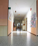 Inside of a long corridor of the kindergarten with drawings on t stock photography