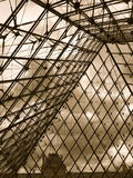 From the inside the Louvre Pyramid. The Louvre Pyramid is a large glass and metal pyramid. It is surrounded by three smaller pyramids. It was completed in 1989 Royalty Free Stock Photo