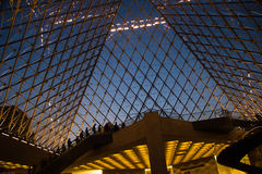 Inside the Louvre Pyramid at twilight Royalty Free Stock Photos