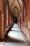 Inside Malbork castle. Narrow corridor in Malbork castle, Poland Royalty Free Stock Photos