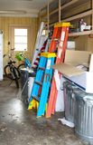 Inside of messy garage with bikes and ladders and American flag and boxes and more - selective focus royalty free stock images