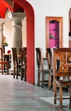 Inside a Mexican restaurant. Tables and chairs inside a Mexican restaurant Stock Photo