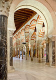 Inside the Mezquita of Cordoba, Spain. Arches and incredible architecture inside the Mezquita (the Great Mosque), one of the most famous landmarks in Andalusia Royalty Free Stock Image