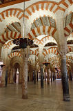 Inside the Mezquita of Cordoba, Spain. Arches and incredible architecture inside the Mezquita (the Great Mosque), one of the most famous landmarks in Andalusia Royalty Free Stock Photo