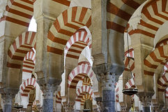 Inside the Mezquita of Cordoba, Spain. Arches and incredible architecture inside the Mezquita (the Great Mosque), one of the most famous landmarks in Andalusia Stock Images