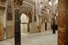 Inside the Mezquita of Cordoba, Spain. Arches and incredible architecture inside the Mezquita (the Great Mosque), one of the most famous landmarks in Andalusia Royalty Free Stock Photography