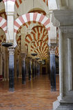 Inside the Mezquita of Cordoba, Spain. Arches and incredible architecture inside the Mezquita (the Great Mosque), one of the most famous landmarks in Andalusia Royalty Free Stock Images