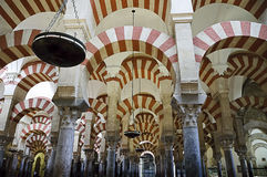 Inside the Mezquita of Cordoba, Spain. Arches and incredible architecture inside the Mezquita (the Great Mosque), one of the most famous landmarks in Andalusia Stock Image