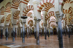 Inside the Mezquita of Cordoba, Spain. Arches and incredible architecture inside the Mezquita (the Great Mosque), one of the most famous landmarks in Andalusia Stock Photography