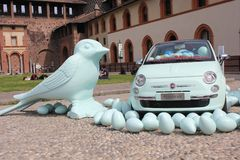 Inside the Milan Sforza Castle, plastic birds on the floor with a Fiat 500 car Royalty Free Stock Photography
