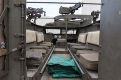 Inside Military Track: Seats and Submachine Guns Royalty Free Stock Images