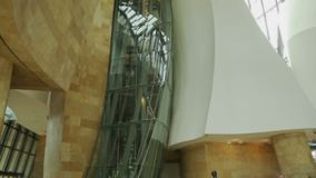 Inside of modern building, full height of curved walls with glass shaft, museum. Stock footage stock video footage